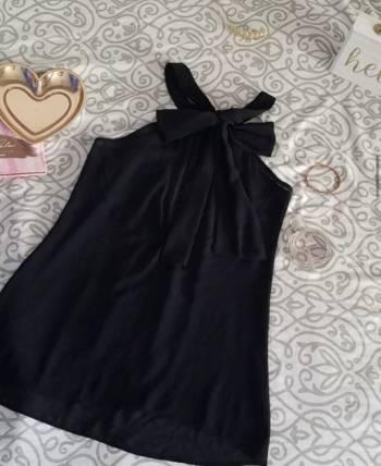 Foto Carousel Producto: Blusa halter negra con moño al frente S GoTrendier