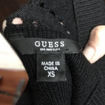 Foto Carousel Producto: Vestido negro tejido de punto GoTrendier