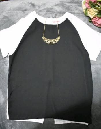 Foto Carousel Producto: Blusa C&A blanco y negro con cierre GoTrendier