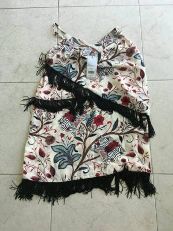 Foto Carousel Producto: Vestido flecos estampado GoTrendier