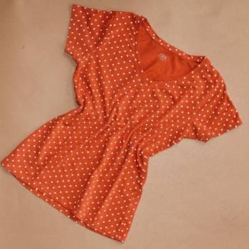 Foto Carousel Producto: Playera color naranja con lunares GoTrendier