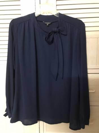 Foto Carousel Producto: Elegante blusa de gasa con moño GoTrendier