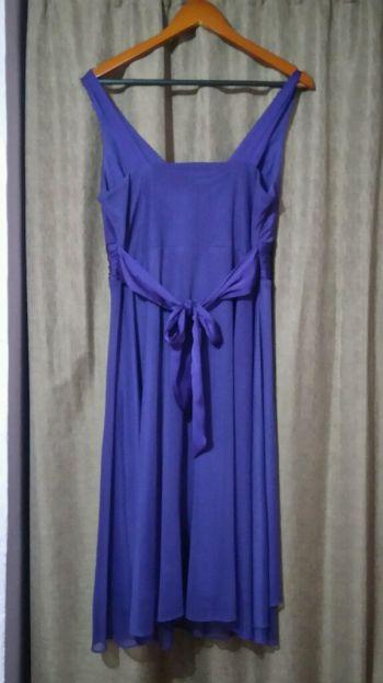 Foto Carousel Producto: Vestido morado con detalle de flor y cinta  GoTrendier
