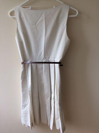 Foto Carousel Producto: Vestido beige tableado GoTrendier