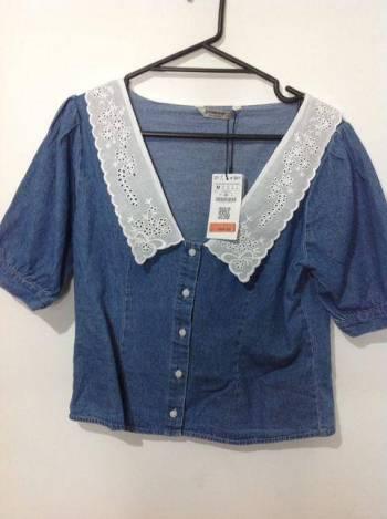 Foto Carousel Producto: Blusa mezclilla cuello bobo GoTrendier