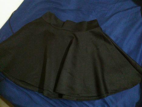 Foto Carousel Producto: Falda circular negra GoTrendier