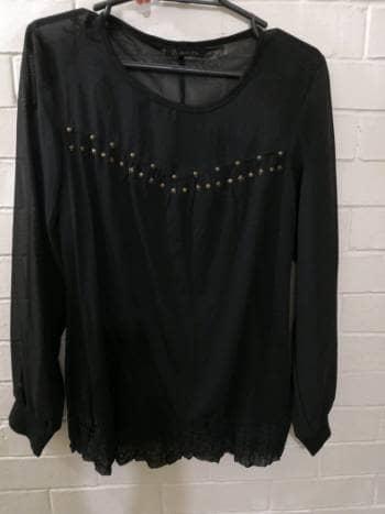 Foto Carousel Producto: Blusa con transparencias negras GoTrendier