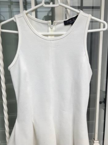 Foto Carousel Producto: Bonita blusa Peplum blanca GoTrendier