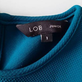 Foto Carousel Producto: Blusa sin mangas formal con olan GoTrendier