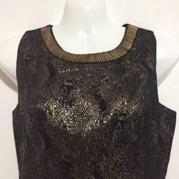Foto Carousel Producto: Vestido corto dorado y negro lindo  GoTrendier