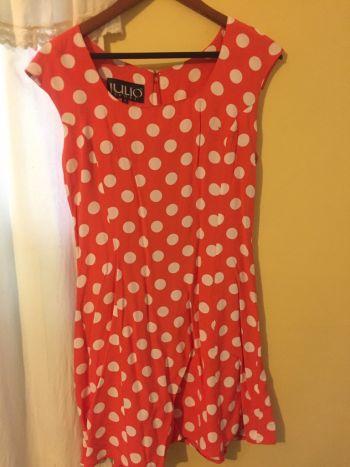 Foto Carousel Producto: Vestido anaranjado con lunares blancos GoTrendier