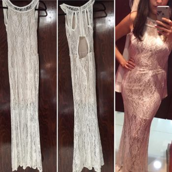 Foto Carousel Producto: Vestido maxi de encaje blanco GoTrendier