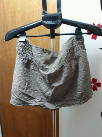 Foto Carousel Producto: Mini falda café con bolsas  GoTrendier