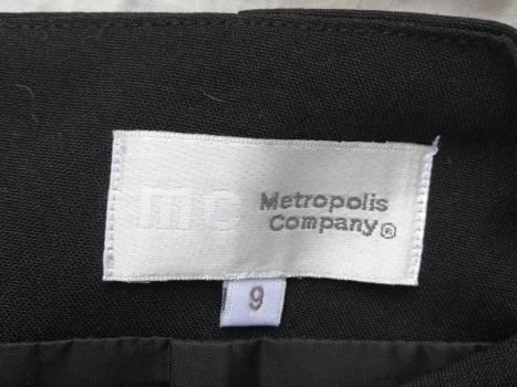 Foto Carousel Producto: 2x1 Falda tableada negra  GoTrendier