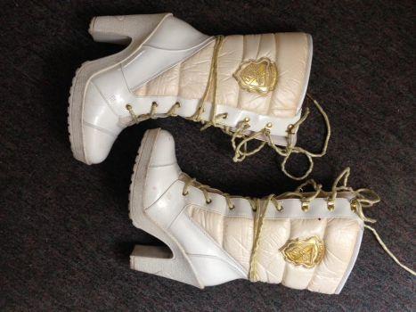 Foto Carousel Producto: Botas blancas Baby Phat GoTrendier