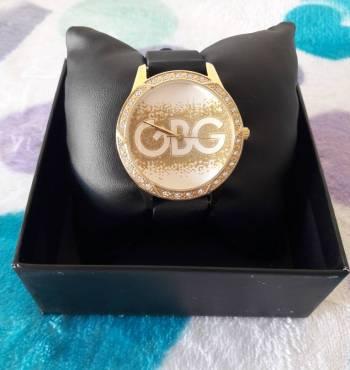 Foto Carousel Producto: Reloj Guess brillos dorados GoTrendier