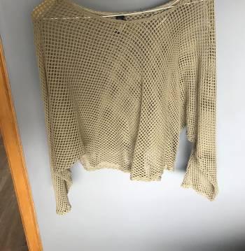 Foto Carousel Producto: Sueter de Zara color beige con hoyos GoTrendier