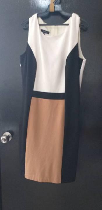 Foto Carousel Producto: Vestido blanco,cafe y negro GoTrendier