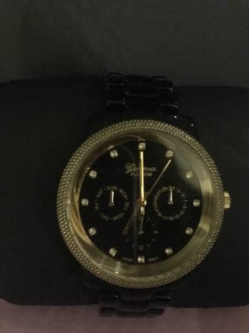 Foto Carousel Producto: Reloj negro y dorado GoTrendier