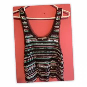 Foto Carousel Producto: Blusa con incrustaciones de perlas. GoTrendier