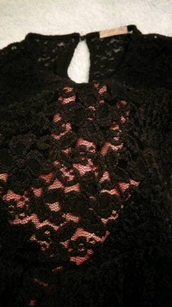 Foto Carousel Producto: Peplum negra encaje quarry girl GoTrendier