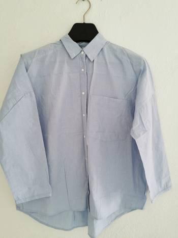Foto Carousel Producto: Camisa oversize marca Stradivarius GoTrendier