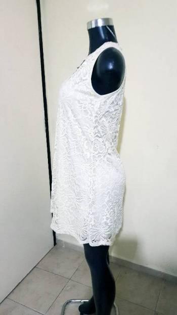 Foto Carousel Producto: Vestido blanco corto GoTrendier