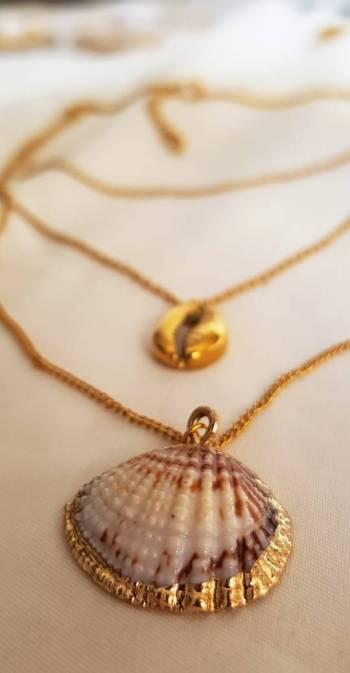 Foto Carousel Producto: Collar Triple Conchas Doradas GoTrendier