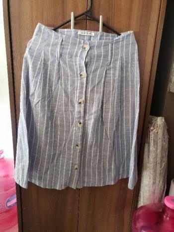Foto Carousel Producto: Falda con botones verano  GoTrendier