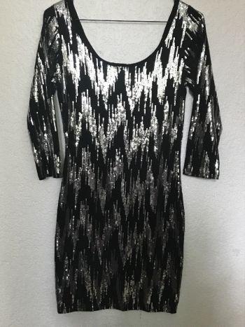 Foto Carousel Producto: Vestido negro con lentejuela GoTrendier