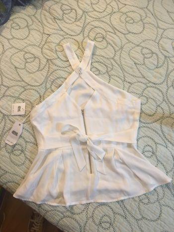 Foto Carousel Producto: Blusa blanca halter con moño GoTrendier
