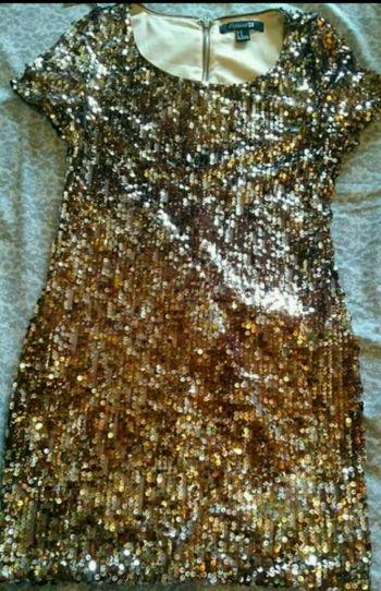 Foto Carousel Producto: Vestido de lentejuelas dorado GoTrendier