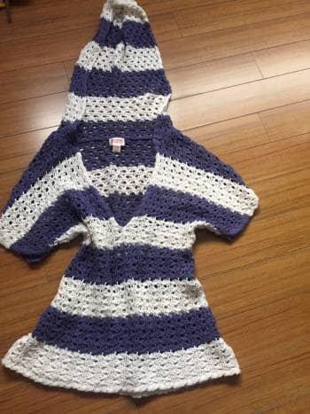 Foto Carousel Producto: Blusa crochet con gorro GoTrendier